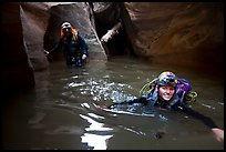 Canyoneers negotiating a deep pool in Pine Creek Canyon. Zion National Park, Utah ( color)