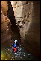 Canyoneers swim into narrow corridor, Pine Creek Canyon. Zion National Park, Utah ( color)