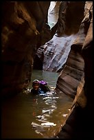 Woman in deep water of dark narrows, Pine Creek Canyon. Zion National Park, Utah ( color)