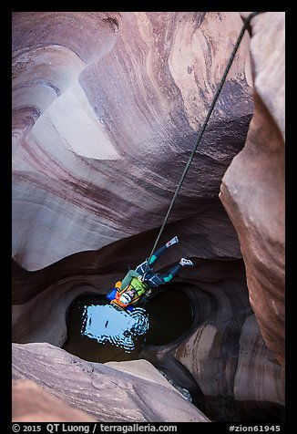 Free rappel seen from above in Pine Creek Canyon. Zion National Park, Utah (color)