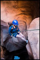 Woman setting out for free rappel in Pine Creek Canyon. Zion National Park, Utah ( color)