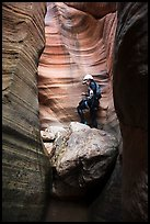 Canyoneer above chockstone, Keyhole Canyon. Zion National Park, Utah ( color)