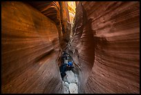 Canyoneers squeezing in Keyhole Canyon. Zion National Park, Utah ( color)