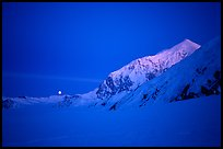 Mt Foraker and moon at twilight. Denali National Park, Alaska, USA.