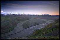 Wide valley with braided rivers and Alaska Range at sunrise from Polychrome Pass. Denali National Park, Alaska, USA.