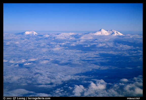 Summit of Mt Foraker and Mt Mc Kinley emerging from  clouds. Denali National Park (color)