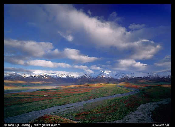 Wide braided rivers, Alaska Range, and clouds, late afternoon. Denali National Park, Alaska, USA.