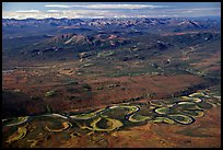 Aerial view of plain with meandering Alatna river and mountains. Gates of the Arctic National Park, Alaska, USA.