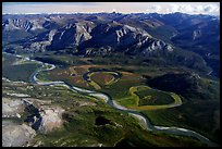 Aerial view of vast landscape of meandering Alatna river and mountains. Gates of the Arctic National Park, Alaska, USA.