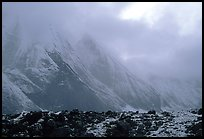Fresh snow dusts the Arrigetch Peaks. Gates of the Arctic National Park, Alaska, USA.