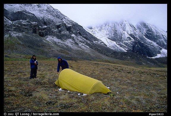 Backpackers camp at the base of the Arrigetch Peaks. Gates of the Arctic National Park, Alaska (color)
