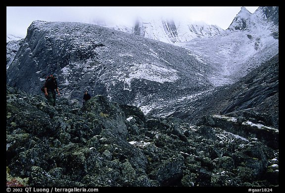 Backpackers on boulder fields in Aquarius Valley. Gates of the Arctic National Park, Alaska (color)