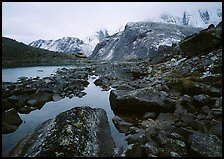 Arrigetch peaks above pond in Aquarius Valley. Gates of the Arctic National Park ( color)