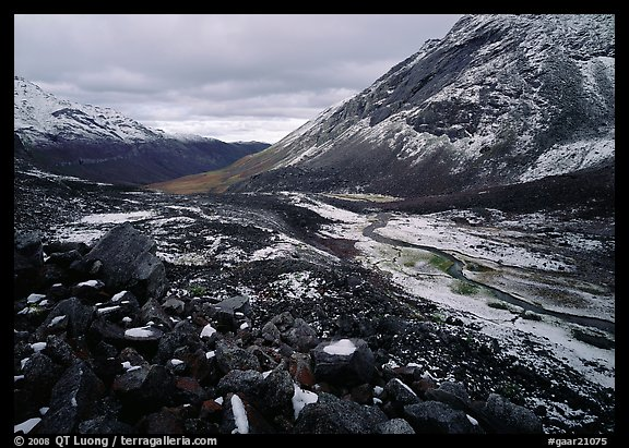 Boulders, valleys and slopes with fresh snow in cloudy weather. Gates of the Arctic National Park (color)