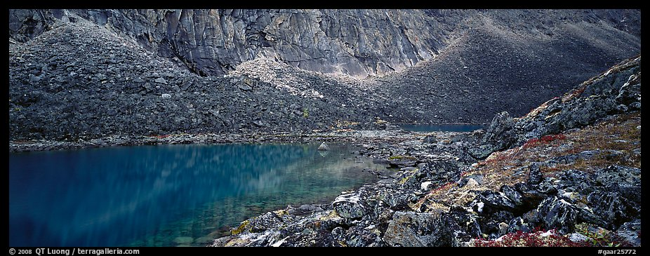 Turquoise lake and scree slopes. Gates of the Arctic National Park (color)