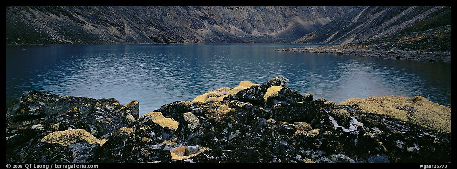 Dark rocks, lichen, and mountain lake. Gates of the Arctic National Park (color)