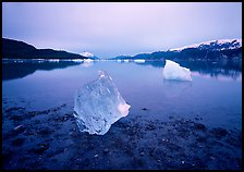 Beached translucent iceberg and Muir inlet at dawn. Glacier Bay National Park, Alaska, USA. (color)