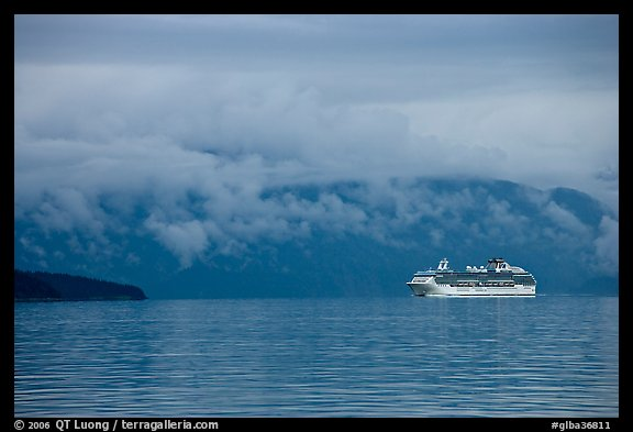 Cruise vessel in blue seascape. Glacier Bay National Park, Alaska, USA.
