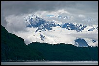 Dark ridge and cloud shrouded peaks, West Arm. Glacier Bay National Park, Alaska, USA.