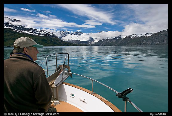 Man sitting at the bow of a small boat. Glacier Bay National Park (color)