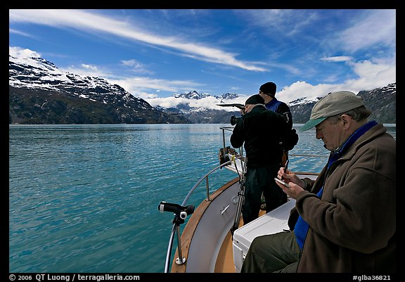 Film producer taking notes as crew films. Glacier Bay National Park, Alaska, USA.