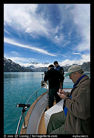 Movie producer taking notes as crew films. Glacier Bay National Park (color)
