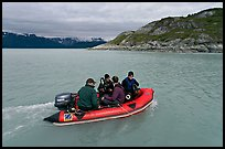 Film crew preparing for landing in a Zodiac. Glacier Bay National Park, Alaska, USA. (color)