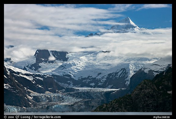 Pointed peaks of Fairweather range emerging from clouds. Glacier Bay National Park (color)