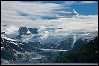 Pointed peaks of Fairweather range emerging from clouds. Glacier Bay National Park, Alaska, USA.