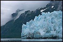 Terminal front of Margerie Glacier with blue ice. Glacier Bay National Park, Alaska, USA. (color)