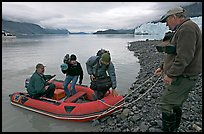 Film crew lands near Margerie Glacier. Glacier Bay National Park, Alaska, USA. (color)