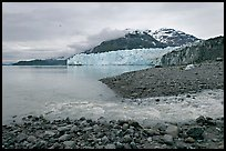 Stream flowing into Tarr Inlet, and Margerie Glacier. Glacier Bay National Park, Alaska, USA.