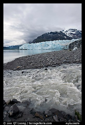 Stream flowing into Tarr Inlet, with Margerie Glacier in background. Glacier Bay National Park (color)