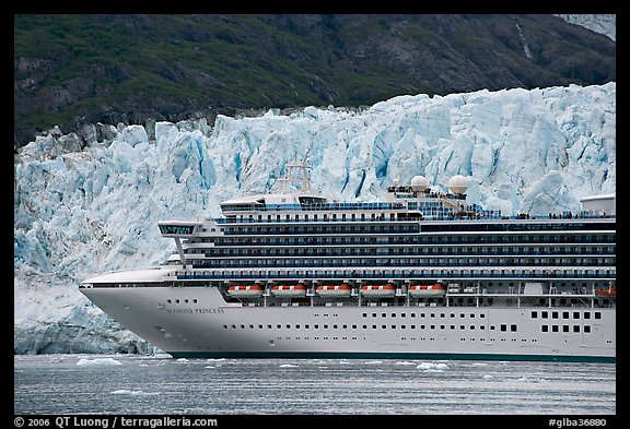 Cruise ship dwarfed by the face of Margerie Glacier. Glacier Bay National Park, Alaska, USA.