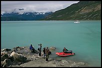 Film crew met by a skiff after shore excursion. Glacier Bay National Park, Alaska, USA. (color)