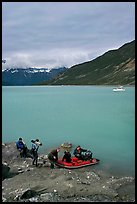Film crew embarking on a skiff after shore excursion. Glacier Bay National Park, Alaska, USA.