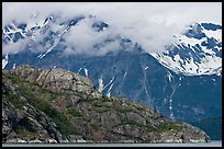 Rocky ridge and snowy peaks, West Arm. Glacier Bay National Park, Alaska, USA. (color)