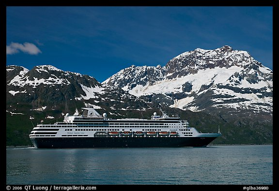 Cruise ship and snowy peaks. Glacier Bay National Park, Alaska, USA.
