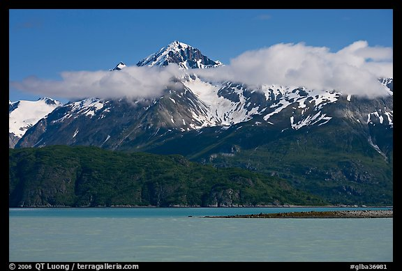 Snowy peaks and clouds raising above turquoise waters in sunny weather. Glacier Bay National Park (color)