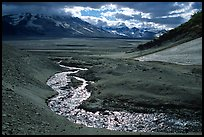 Stream flows from the hills into the floor of the Valley of Ten Thousand smokes. Katmai National Park, Alaska, USA.