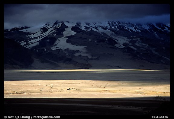 A break in the clouds illuminate the floor of the Valley of Ten Thousand smokes. Katmai National Park (color)