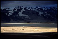 A break in the clouds illuminate the floor of the Valley of Ten Thousand smokes. Katmai National Park ( color)