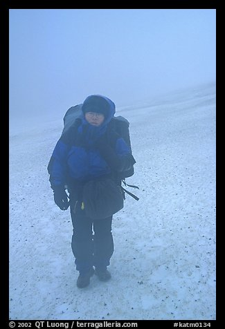 Backpacker in white-out conditions, Valley of Ten Thousand smokes. Katmai National Park, Alaska (color)