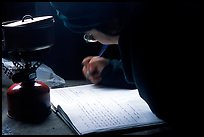 Backpacker writes into the visitor log in the USGS research cabins, Valley of Ten Thousand smokes. Katmai National Park, Alaska (color)