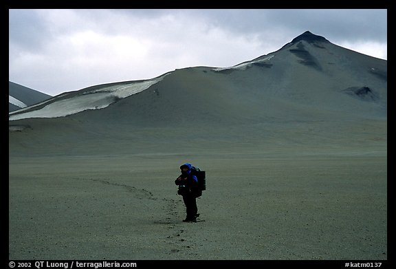 Backpacker leaves the Baked mountain behind, Valley of Ten Thousand smokes. Katmai National Park, Alaska (color)