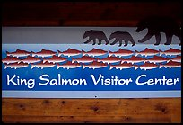 Bears and salmon on visitor center sign. Katmai National Park ( color)