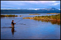 Man fishing for salmon in the Brooks river. Katmai National Park, Alaska, USA. (color)