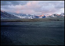 Ash plain, and mountains at sunset, Valley of Ten Thousand smokes. Katmai National Park, Alaska, USA.