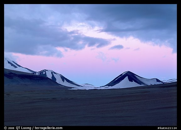 Mt Meigeck emerging above ash plain of Valley of Ten Thousand Smokes at dusk. Katmai National Park, Alaska, USA.