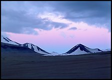 Mt Meigeck emerging above ash plain of Valley of Ten Thousand Smokes at dusk. Katmai National Park, Alaska, USA. (color)